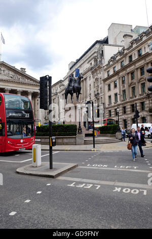 London, United Kingdom. Looking across Threadneedle street towards The Royal Exchange Building and the statue of - Stock Photo
