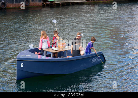 GoBoat picnic and fishing  trip in the canals of Copenhagen Harbour - Stock Photo