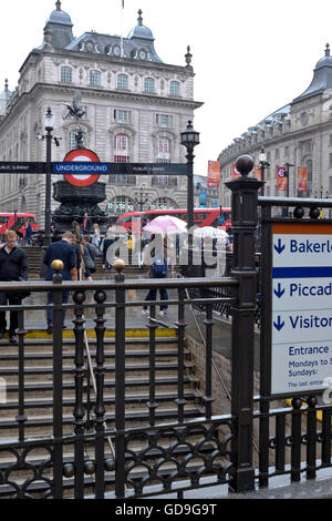 Piccadilly Circus London. Steps from the Piccadilly Circus underground station lead up Piccadilly Square - Stock Photo