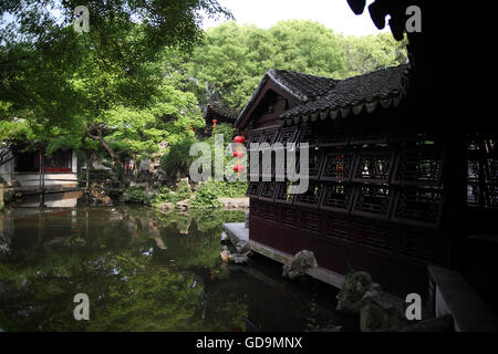 A house, a pond, vegetation and Chinese lanterns in the Tuisi Garden, a typical old Chinese garden built in 1885. - Stock Photo