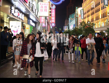 Crowds of people roam along the fashionable Nanjing Street in the evening of the 1st of May holiday weekend.  Shanghai, - Stock Photo