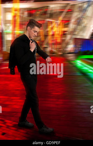 guy checking time while walking in rush - Stock Photo