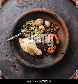 Spices Ingredients for Indian masala tea on dark background - Stock Photo