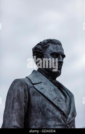 Head of a statue of Robert Stephenson, the the railway engineer outside Euston Railway Station in London - Stock Photo