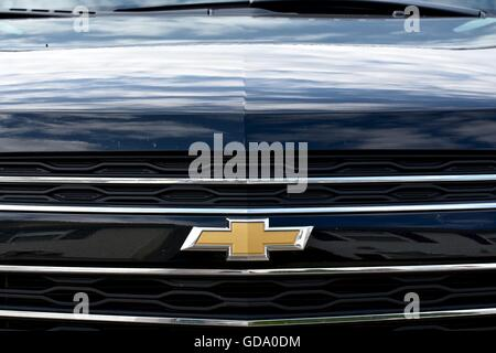 The Front End Of A Black Chevy Vehicle Showing The Chevy Symbol Up