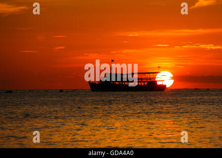 sunset on the beach with fishing boat in Pattaya, Thailand