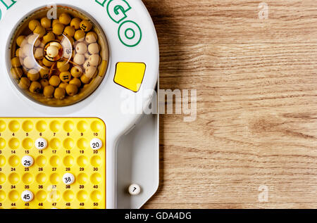 Electronic bingo game on wooden board. Horizontal image viewedfrom above. - Stock Photo