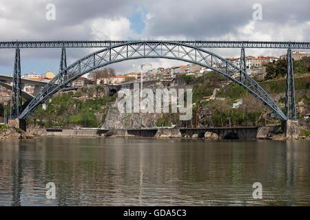 Maria Pia Bridge in Porto, Portugal, iron railway arch bridge over Douro river, opened in 1877, construction of - Stock Photo