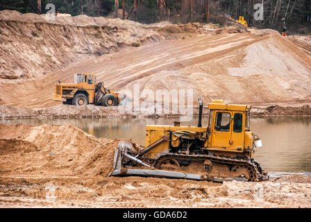 Tractors in a quarry. - Stock Photo