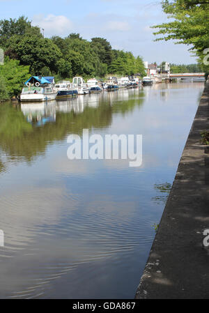 AALST, BELGIUM, JULY 9 2016: View of the river Dender as it runs through Aalst. The Dender is navigable for cargo - Stock Photo