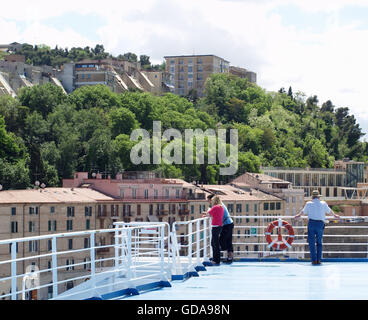 View of passengers looking ashore at Ancona Port from onboard Minoan Lines Ferry Cruise Olympia - Stock Photo