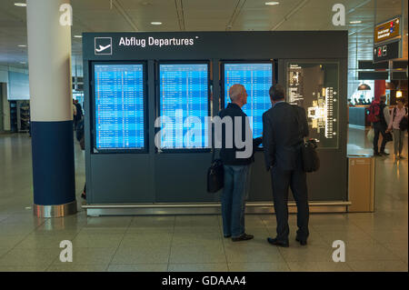 GERMANY, Munich, June 6, 2016. Passengers inside the Lufthansa Terminal at Munich Airport. - Stock Photo