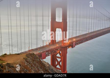 Fog and Mist over the Golden Gate Bridge in San Francisco, California, USA - Stock Photo