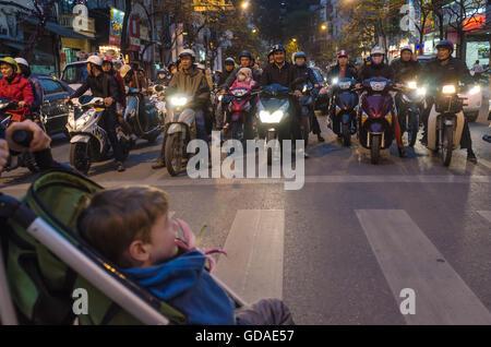Vietnam, Hanoi, scooter on a zebras in Hanoi - Stock Photo