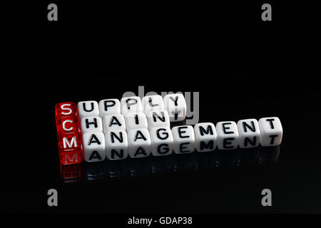 SCM Supply Chain Management written on dices on black background - Stock Photo