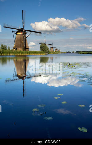 The windmills of Kinderdijk are one of the Dutch UNESCO world heritage sites - Stock Photo