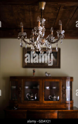 a beautiful sparkling chandelier in old interior - Stock Photo