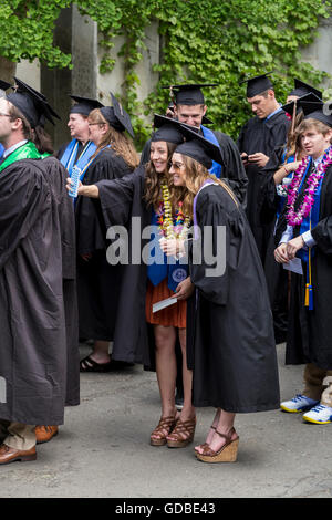university students attending graduation ceremony at Sonoma State University in Rohnert Park in Sonoma County in - Stock Photo