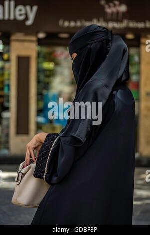 Veiled Muslim Woman Shopping - Stock Photo