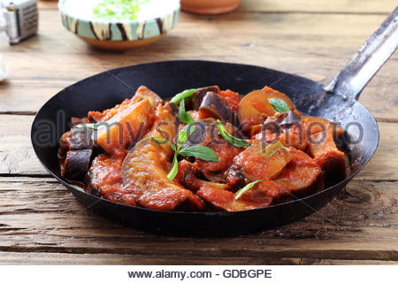 Baked eggplant with tomatoes - Stock Photo