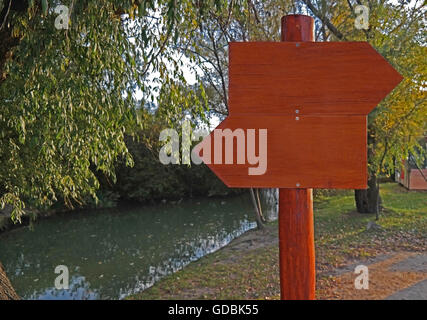 A wooden signpost without any info. - Stock Photo