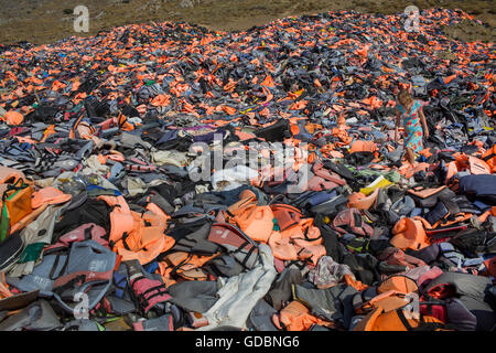 life jackets used by refugees to cross from Turkey to Greece. They are collected and dumped at the waste pit at - Stock Photo