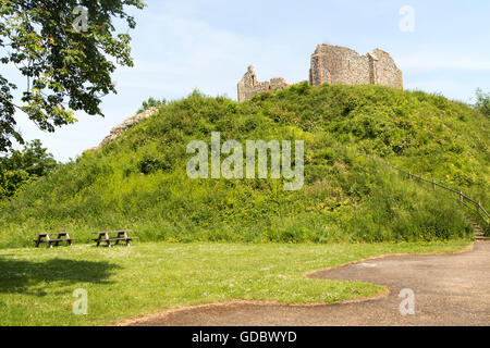 Norman motte and bailey castle with Victorian building ruin Eye, Suffolk, England, UK - Stock Photo