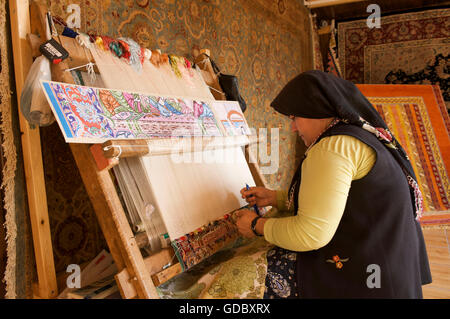 Carpet weaving in Side, Turkey - Stock Photo