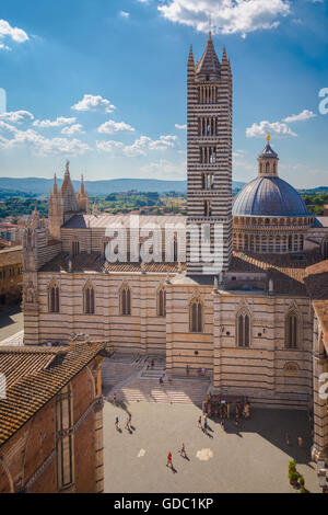 Siena, Siena Province, Tuscany, Italy.  The Romanesque-Gothic duomo, or cathedral, built in the 13th century. - Stock Photo
