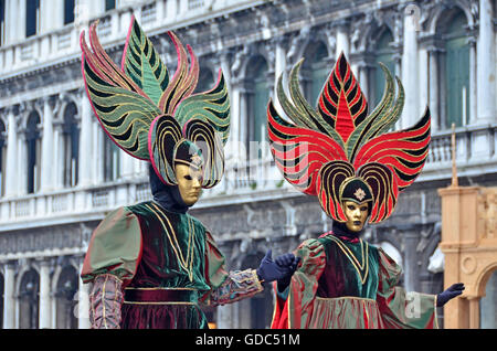 VENICE,ITALY - Matching carnival couple in St Marks Square the 2015 Venice Carnival: - Stock Photo