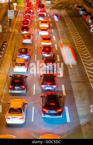 Cars,Automobiles,rush-hour,traffic,blur,brake lights,Germany,Europe,automobiles,Cologne,night,North Rhine-Westphalia, - Stock Photo