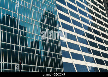 Blue skyscraper office buildings located in downtown New York City reflecting images of adjacent skyscrapers - Stock Photo
