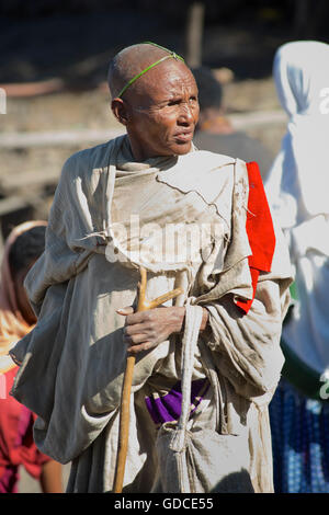 Ethiopian woman at market. Market day in Lalibela. Ethiopia. Easter Sunday palm around her head. - Stock Photo