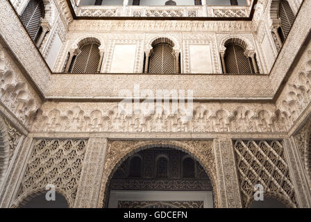 View of the majestic plaster decoration of the Patio de las Munecas, Alcazar of Sevilla, Spain - Stock Photo