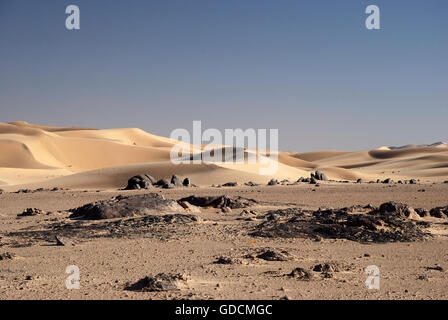 Sand dunes and rocks in the desert in Oman - Stock Photo
