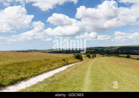 South Downs Way, looking towards the village of Alfriston from Windover Hill, East Sussex, England, UK - Stock Photo