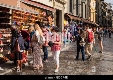 Tourists at souvenir stalls in the Piazza San lorenzo, Florence, Tuscany, Italy - Stock Photo