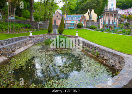 Fishpond, Portmeirion, with Salutation and Gloriette buildings beyond. - Stock Photo