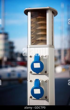 Outdoor electric power outlet - Stock Photo