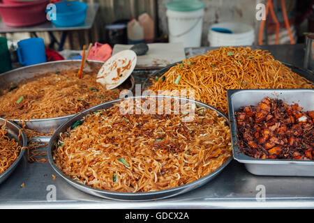 Kway teow fried noodles at the Kimberly Street Food Night Market, George Town, Penang, Malaysia. - Stock Photo