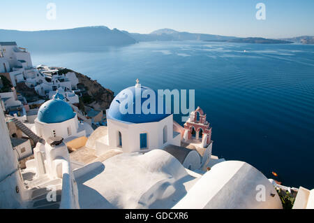Village of Oia overlooking Caldera flooded crater, Santorini, Greece - Stock Photo