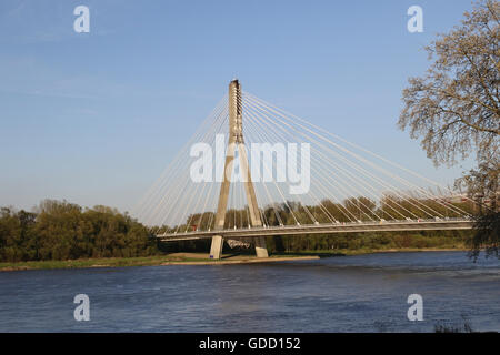 Suspension bridge over Vistula river in Warsaw - Stock Photo