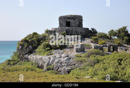 god of winds temple in the ancient mayan walled city of tulum mexico - Stock Photo