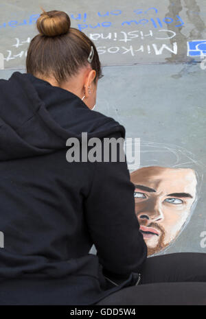 Street artist chalk drawing at Trafalgar Square, London in July - Stock Photo