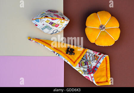 pincushions and sewing articles - Stock Photo