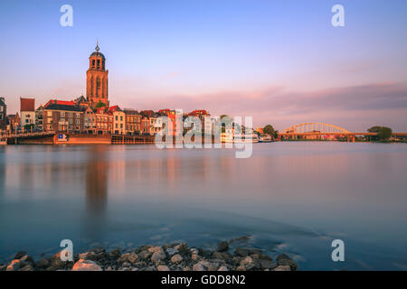 The old historic town of Deventer along the river IJssel in the Netherlands - Stock Photo