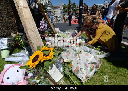 Nice, France. 15th July, 2016. People have put down floral tributes to the victims near the scene in Nice, France, - Stock Photo