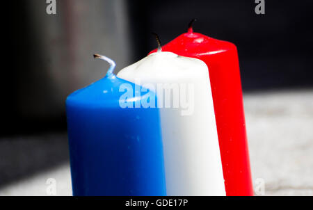 Gijon, Spain. 15th July, 2016. Candles with colors of the flag of France placed at Mayor Square of Gijón, commemorating - Stock Photo