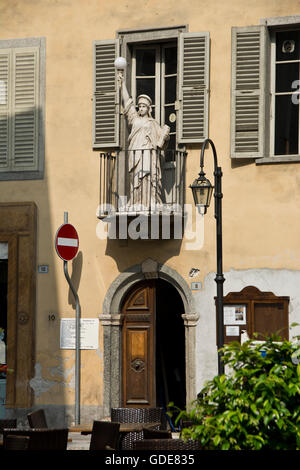 Italy,Europe,Northern Italy,Piemont,Domodossola,Old Town,statue,balcony - Stock Photo