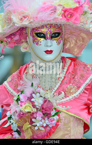 VENICE,ITALY - Beautiful pink floral costume at the 2015 Venice Carnival: - Stock Photo